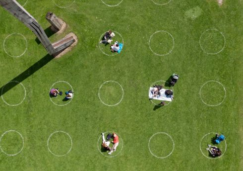 Visitors to the Royal Hospital Kilmainhan on the front lawn of the Irish Museum of Modern Art, in Dublin, in socially distant painted circles on the grass. Photograph: Alan Betson/The Irish Times