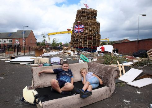 Youngsters at the site of a July 12th bonfire on the Newtownards Road in Belfast. Photograph: Stephen Davison