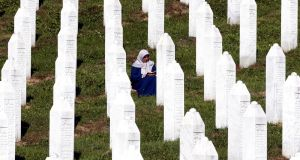 A Bosnian Muslim woman offers prayers during a funeral ceremony for nine newly-identified Bosnian Muslim victims, at the Potocari Memorial Center and Cemetery, in Srebrenica, Bosnia and Herzegovina, on July 11th. Photograph: Fehim Demir/ EPA.