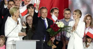 Incumbent president Andrzej Duda flashes a victory sign in Pultusk, Poland on Sunday. Duda, a conservative, emerged victorious from a tight race against liberal Warsaw mayor Rafal Trzaskowski. Photograph: Czarek Sokolowski/AP