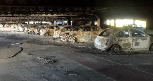 The aftermath of a large fire in the multi-storey parking facility of the Douglas Village Shopping Centre in Cork.