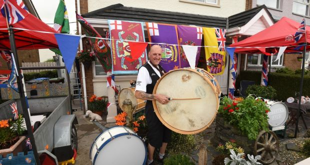 Alan Warke of Different Skins with his collection of Lambeg drums on the Twelth in Newbuildings, Co Derry. Photograph: Trevor McBride