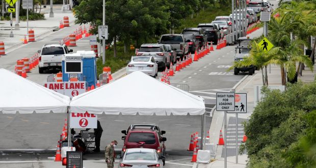 Cars waiting at a Covid-19 testing site at the Miami Beach Convention Centre  on  Sunday. Florida  reported the largest single-day increase in positive coronavirus cases in any one state since the beginning of the pandemic on Sunday. Photograph: Lynne Sladky/AP