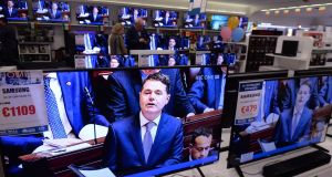 Paschal Donohoe's budget speech from last year on multiple TV screens in Harvey Norman in Airside Retail Park, Dublin. Photograph: Alan Betson