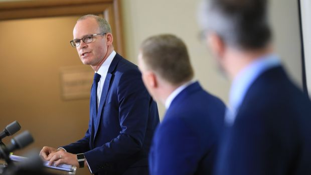 Minister for Foreign Affairs Simon Coveney, Minister for Public Expenditure and Reform Michael McGrath and Minister for Children Roderic O'Gorman hold a press conference in Dublin Castle. Photograph: Julian Behal/PA Wire