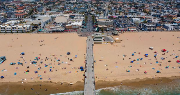 Aerial view of people on the Hermosa Beach, California during a heatwave on Sunday as coronavirus cases reach new record levels in states across the the US. Photograph: David McNew/AFP/Getty