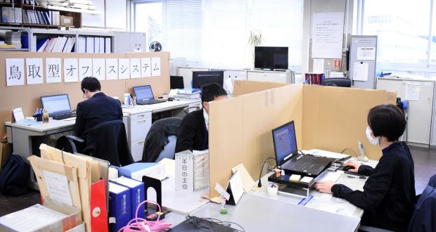 Coronavirus precautions are taken in an office in Tottori, western Japan. Photograph:STR/Getty/AFP