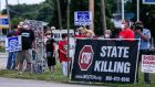 People gather to protest the resumption of federal executions near the US Penitentiary and execution chamber in Terre Haute, Indiana, US. Photograph: Tannen Maury/EPA