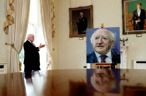 HEADS OF STATE: President Michael D Higgins views his portrait by artist Colin Davidson at Áras an Uachtaráin. Photograph: Maxwell's