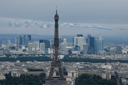 AIR FRANCE: Nine aircraft from the French air force fly over the Eiffel Tower during the annual Bastille Day military parade on the Place de la Concorde in Paris, France. Photograph: Julien de Rosa/EPA