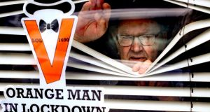 Orangeman Randy Davidson celebrating the Twelfth at home, where he is isolating. Photograph: Niall Carson/PA Wire
