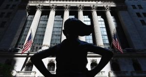 The Fearless Girl statue stands in front of the New York Stock Exchange on Wall Street. Photograph: Angela Weiss/AFP via Getty Images