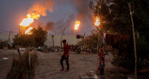 Flares from oil wells light the night sky in Nahran Omar in Iraq. Photograph: Ivor Prickett/New York Times