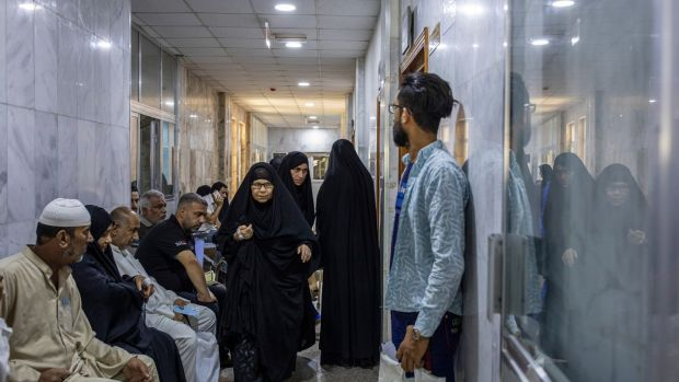 Crowds at a cancer hospital in Basra: The flared gas is enough to power three million homes and burning it is making people sick. Photograph: Ivor Prickett/New York Times