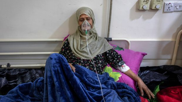 Tukhia Hachim Hashin (67) receives treatment at an overcrowded cancer hospital in Basra. Iraq burns natural gas from oil wells but also imports natural gas. Photograph: Ivor Prickett/New York Times