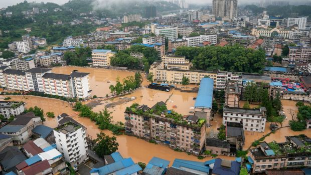 An aerial view shows a flooded part of Enshi City, Hubei province, China on Saturday. Photograph: XIE Chuanhui China Out/ EPA