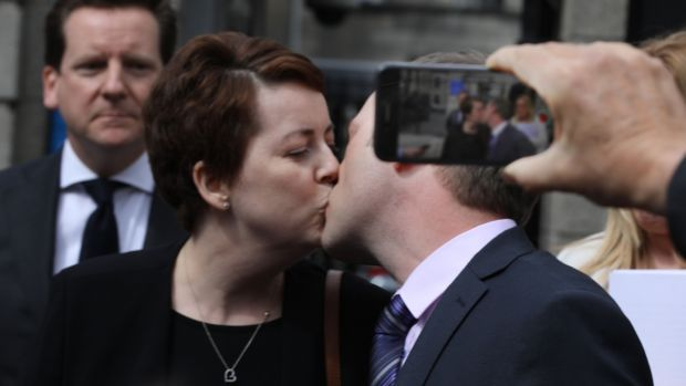 Ruth Morrissey and her husband, Paul share a kiss outside the Four Courts after a High Court judgement in 2019. Photograph: Collins Courts