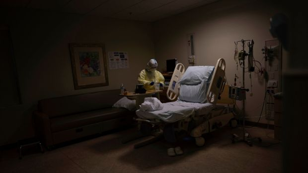 A nurse prepares to release a mother who had given birth after testing positive for the coronavirus, at a DHR Health hospital in Edinburg, Texas. Photograph: Lynsey Addario/New York Times