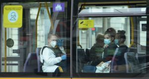 Passengers wearing masks on public transport in Dublin. Photograph: Alan Betson
