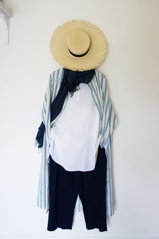 Long block printed shirt Û380, white pull over shirt Û310, indigo trousers Û260, Clementine natural straw boater with extra wide brim Û189.