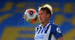 Brighton defender Dan Burn controls the ball during the  Premier League match against Newcastle United at the American Express Community Stadium. Photograph: Mike Hewitt/AFP via Getty Images