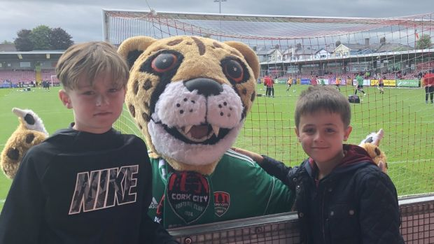 Charlie and Finn Hannigan with the Cork City mascot at a game in Turner's Cross in Cork.