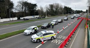 Gardai check motorists destinations and reasons for travelling at a Garda Checkpoint on the N11  Dublin in March.  Photograph: Bryan O Brien / The Irish Times