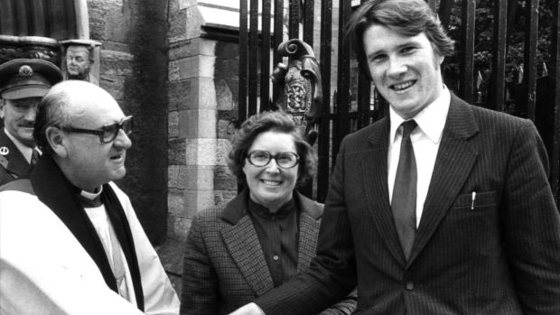 The youngest member of the new Dáil in 1981, Ivan Yates (21), and his mother Elizabeth Yates are welcomed to St Patrick's Cathedral, Dublin, by Victor Griffin. Photograph: Paddy Whelan / The Irish Times