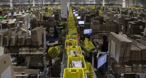 Parcels are processed, almost ready for dispatch, in the outbound area of the Amazon.com fulfillment centre in Castel San Giovanni, Italy.  Photograph: Emanuele Cremaschi/Getty Images