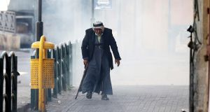 An elderly Palestinian man during clashes in the West Bank city of Hebron. Photograph: Abed al Hashlamoun/EPA