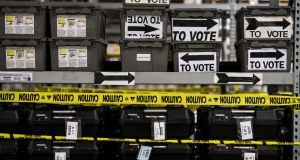 On the day after an election   marred by a lack of polling machines, shelves  of sequestered voting machines, wrapped with yellow caution tape, still sit unrecorded, and unused, at the Fulton County Election Preparation Center in Atlanta, Georgia in November  2018. Photograph:  Melina Mara/The Washington Post via Getty Images