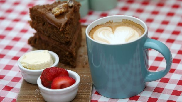 Coffee cake with a latte at the Hazel House cafe. Photograph: Laura Hutton