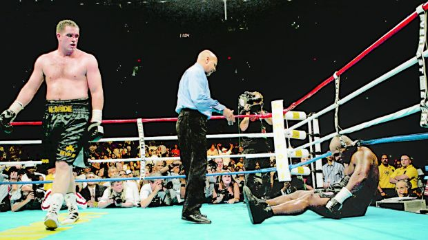 Ireland's Kevin McBride, left, walks away as referee Joe Cortez stands over Mike Tyson in the sixth round of their heavyweight bout on Saturday, June 1th1, 2005, at the MCI Center in Washington. Photo: Pablo Martinez Monsivais/AP Photo