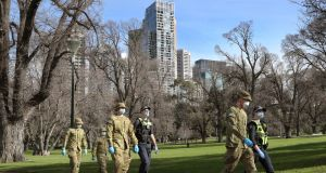 Australian defence force personnel and Victorian police officers patrol Fitzroy Gardens in Melbourne, Victoria, Australia, July 25th 2020. Photograph: David Crosling/EPA