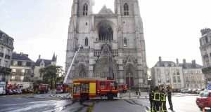File image of firefighters  at work putting out a fire in the cathedral in Nantes, France. Photograph: Sebastien Salom-Gomis/AFP via Getty Images