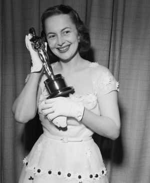 Olivia De Havilland displays her second Oscar, for her role in   The Heiress, in 1949. She also won in 1946. Photograph: Bettmann Archive/Getty Images