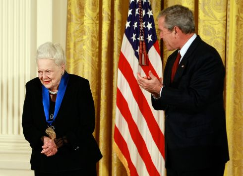 President George W Bush applauds Olivia de Havilland after presenting her with the 2008 National Medals of Arts award at the White House in November 2008. Photograph: Mark Wilson/Getty Images