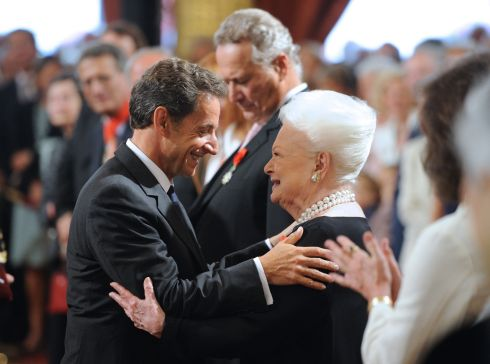 French President Nicolas Sarkozy and Olivia de Havilland after he awarded her the chevalier of the Legion of Honour, in  September  2010 at the Elysee Palace, Paris. Photograph: Eric Feferberg/AFP/Getty Images