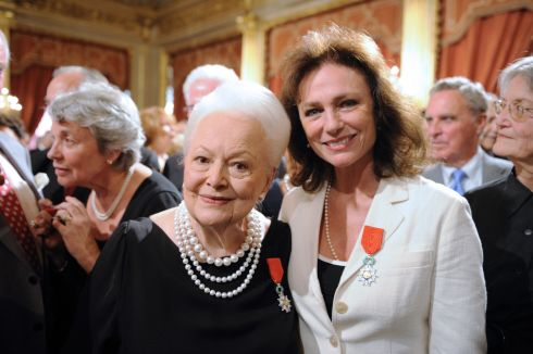 With actor Jacqueline Bisse after they were awarded chevalier of the Legion of Honour by French President Nicolas Sarkozy, in September 2010 at the Elysee Palace,  Paris. Photograph: Eric Feferberg/AFP/Getty Images