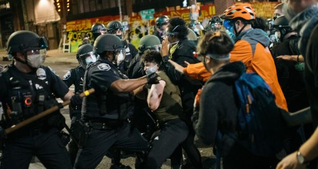 Seattle and Portland declare riots as presence of troops ignites protests