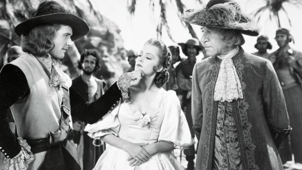 Olivia de Havilland with Errol Flynn and Henry Stephenson in Captain Blood, 1935. Photograph: Getty Images