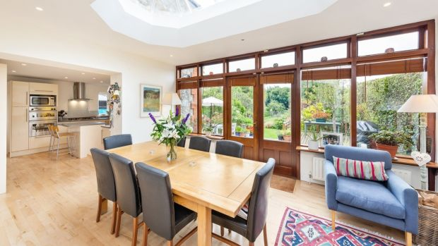 Living-dining-kitchen, an extension added in 1996 that is bright and airy thanks to lantern rooflight overhead
