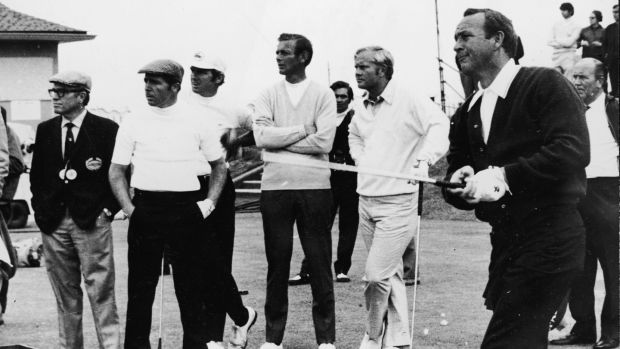 Arnold Palmer drives off of the first tee during the 1970 British Open at St Andrews while Jack Nicklaus and Gary Player look on. Photograph: Express Newspapers/Getty Images