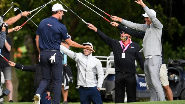 Renato Paratore of Italy receives a guard of honour from fellow European Tour professionals after winning the British Masters at Close House Golf Club. Photograph: Ross Kinnaird/Getty Images