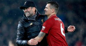 Liverpool manager Jurgen Klopp  with   Dejan Lovren  at Anfield. Photograph: Peter Byrne/PA Wire