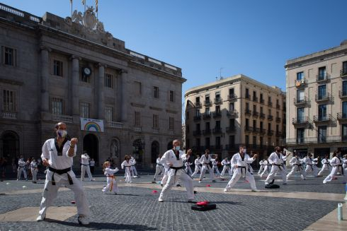 STRONG-ARM TACTICS: Dozens of people practice martial arts in front of the regional government's headquarters in Barcelona, Spain, as a protest against the closure of gyms and martial arts centres in the region due to a surge in coronavirus cases. Photograph: Enric Fontcuberta/EPA