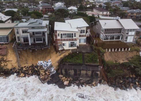 COASTAL EROSION: A photo taken with a drone shows damaged properties along Terrigal Beach after a storm on the Central Coast, New South Wales, Australia. A severe weather warning had been issued for the coast from the southern border to Newcastle.  Photograph: James Gourley/EPA