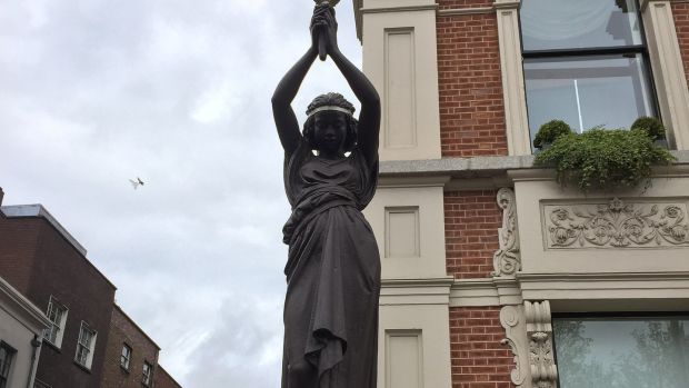 One of the statues depicting slave girls holding torches. Photograph: Wikimedia Commons