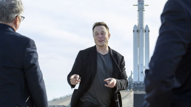 Elon Musk, founder of SpaceX, speaks to reporters, with the company's Falcon Heavy rocket standing by. Photograph: Todd Anderson/The New York Times