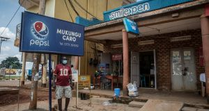 Opoka Francis (40) stands outside his Mukungu Caro bar in Gulu. Photograph: Sally Hayden